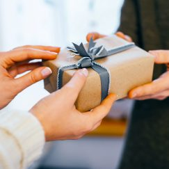 People exchanging a gift card
